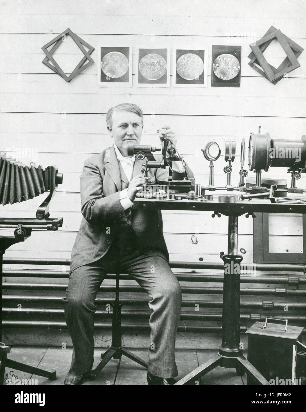 Thomas Alva Edison is shown in his laboratory experimenting with micrography, New Jersey. - Stock Image