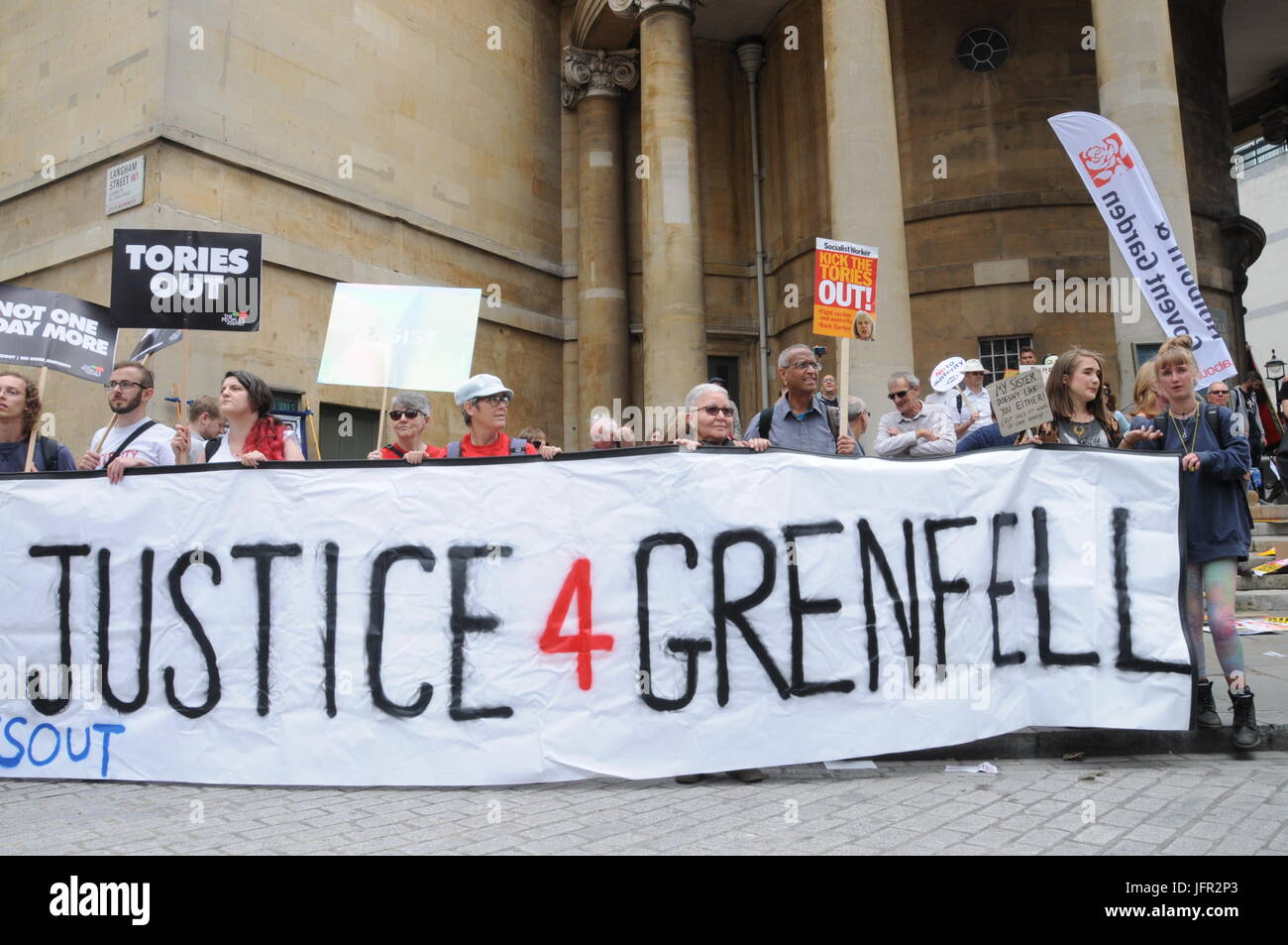 The Justice For Grenfell group join John McDonnell's Anti-Tory March in London. - Stock Image