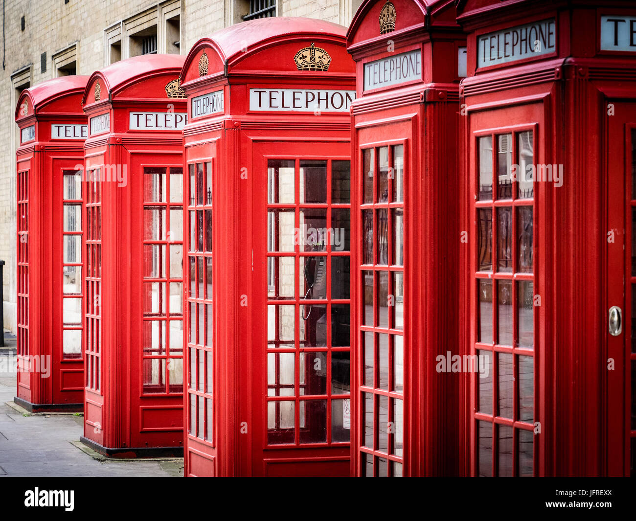 Traditional Red British Telephone Boxes, designed by Sir Giles Gilbert Scott, in London's West End - Stock Image