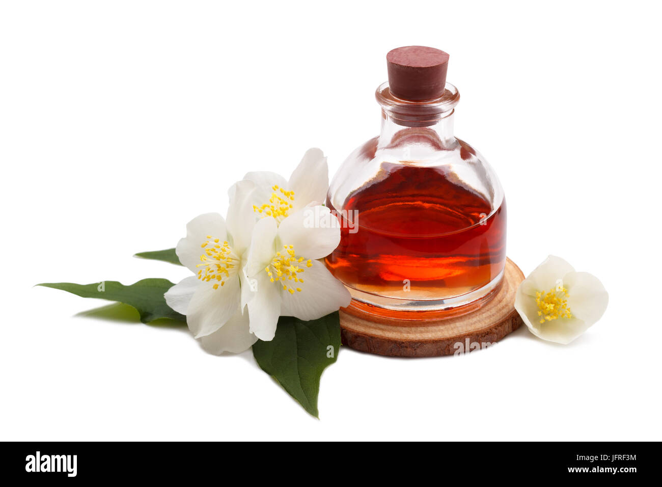 Perfume bottle jasmine flower stock photos perfume bottle jasmine essential oil with jasmine flower stock image izmirmasajfo