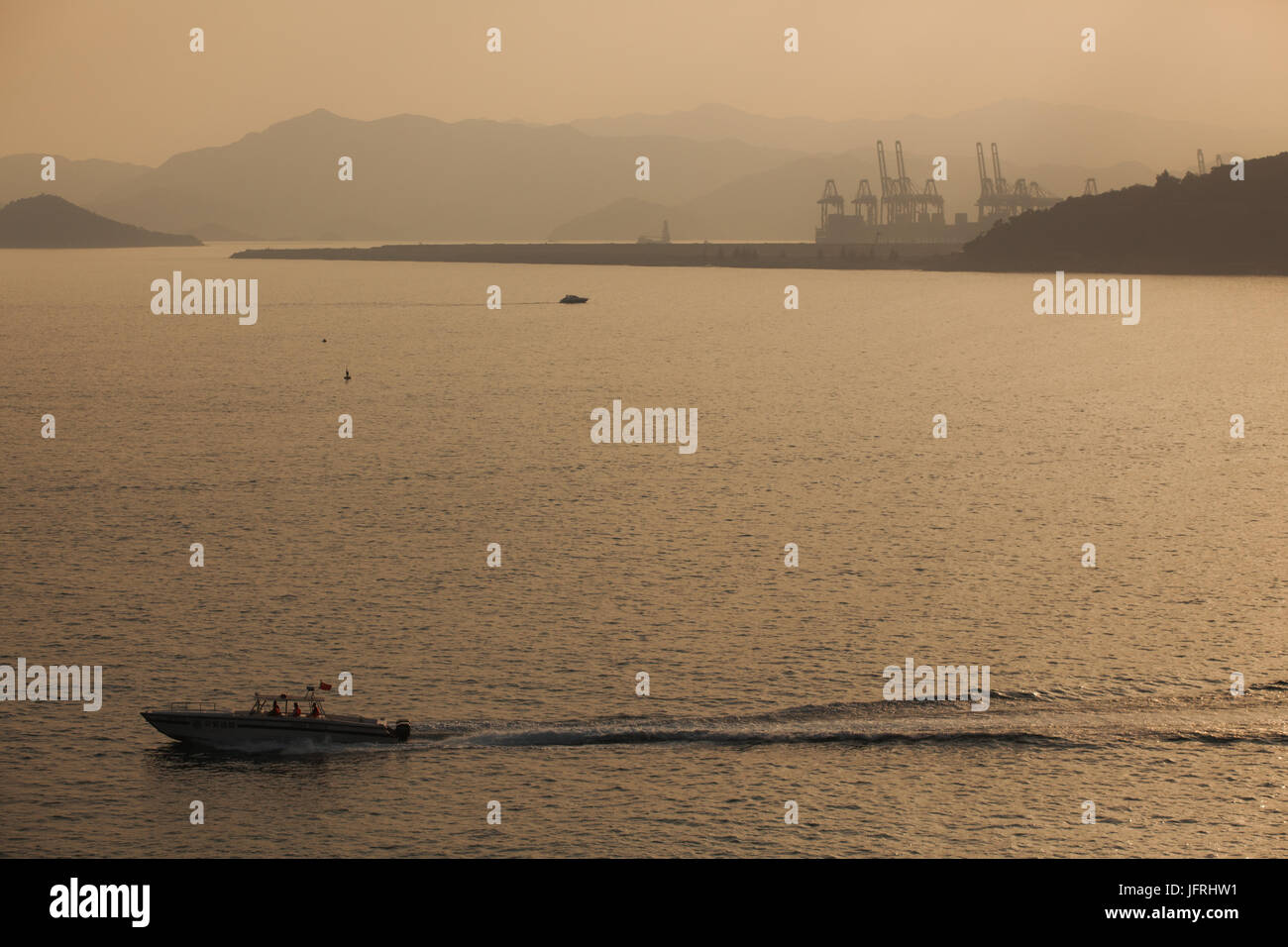 Chinese coastguard speedboat at daily mission; Yantian harbor area, Dameisha beach, Shenzhen, Guangdong, China; - Stock Image