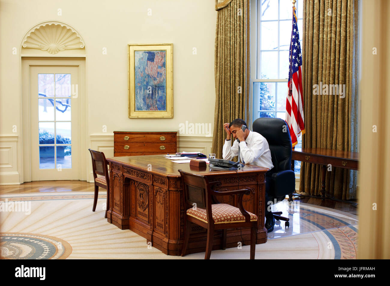 President Barack Obama in the Oval Office 1/28/09. Official White House Photo by Pete Souza - Stock Image