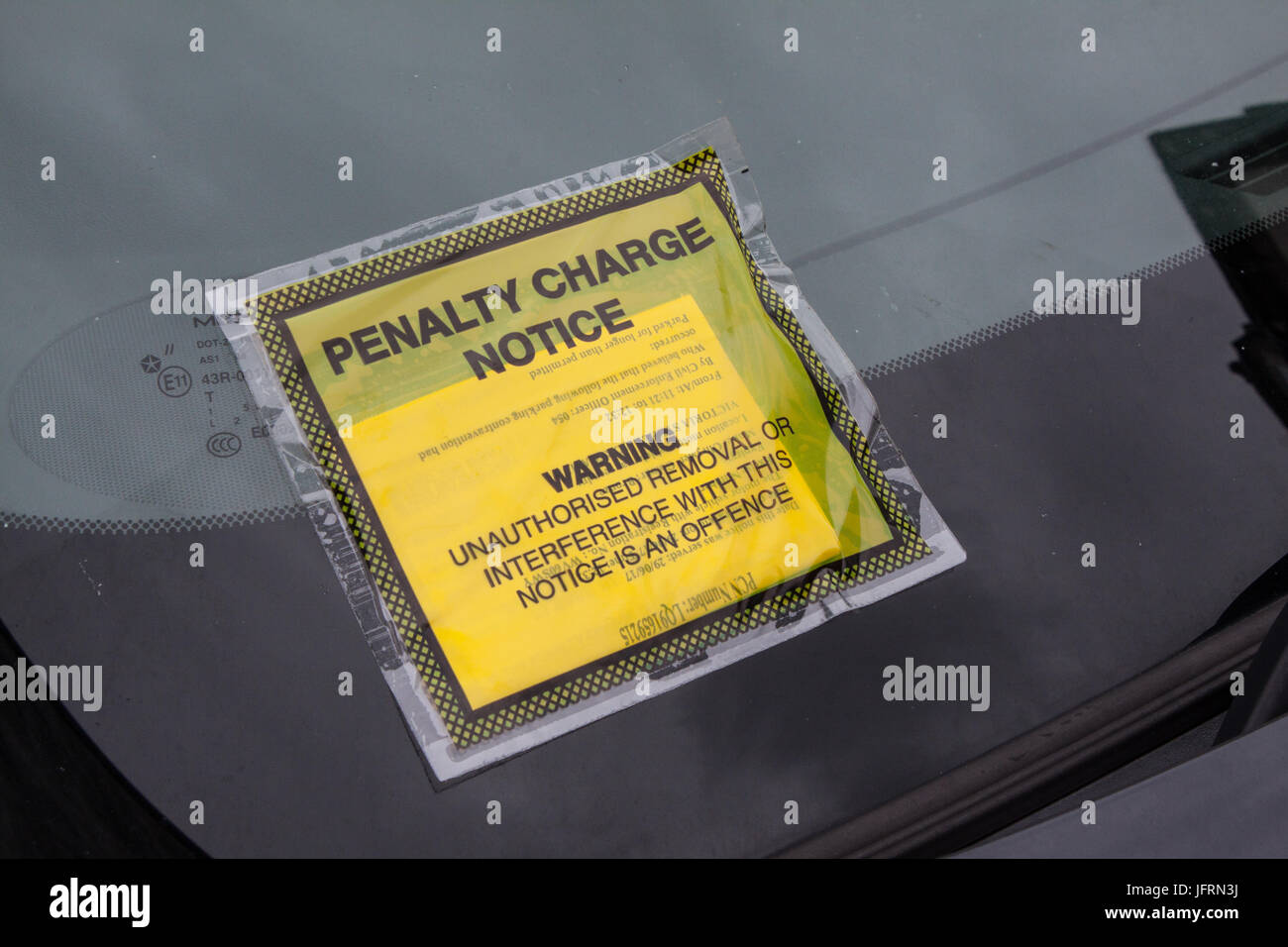 Penalty Charge Notice fixed to Windscree - Stock Image