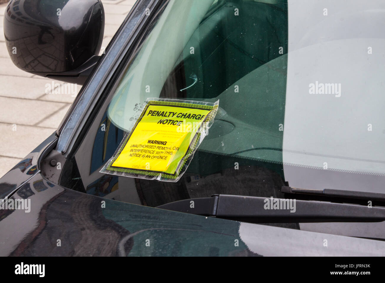 Penalty Charge Notice fixed to Windscreen - Stock Image