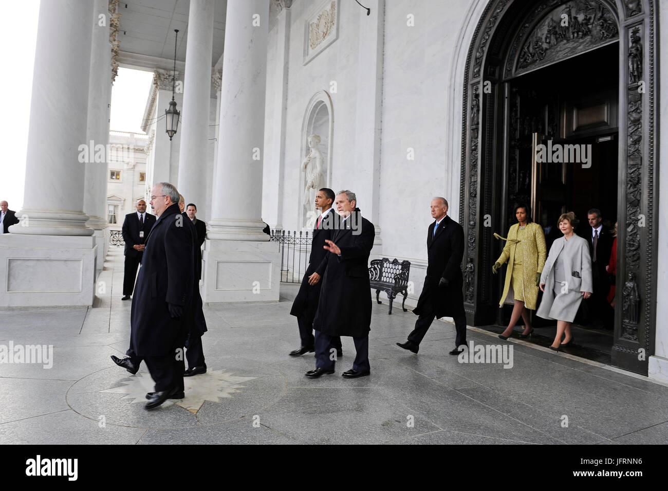 Former president George W. Bush is escorted by President Barack Obama on the U.S. Capitol east steps as he and Laura - Stock Image
