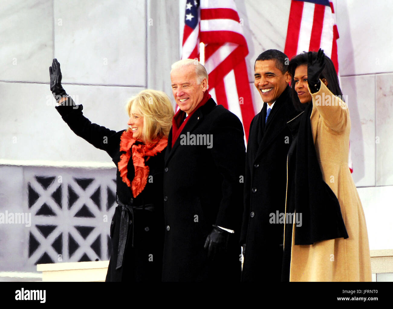 Jill Biden, Vice President-elect Joe Biden, President-elect Barack Obama, and Michelle Obama wave to the crowd gathered - Stock Image