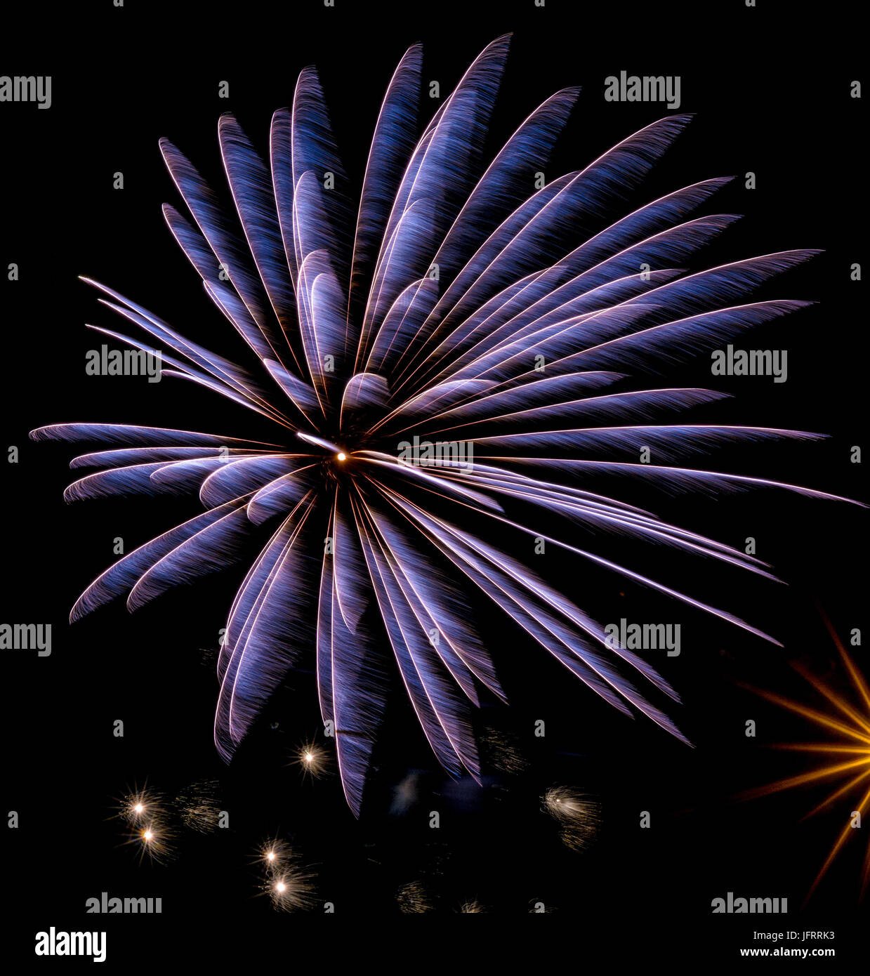 Firework in blue on black background in graphical color painting style - Stock Image