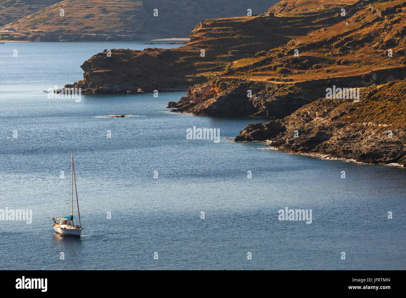 Sail boat at the coast of Kythnos island in Greece. - Stock Image