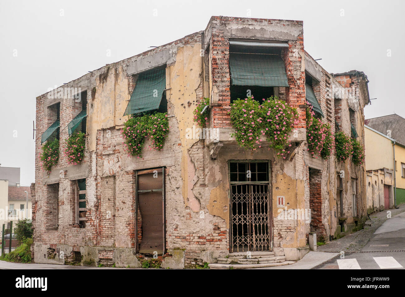 A battle scarred memorial building in Vukovar, Croatia, showing damages from the Yugoslav Wars in the 90s. - Stock Image