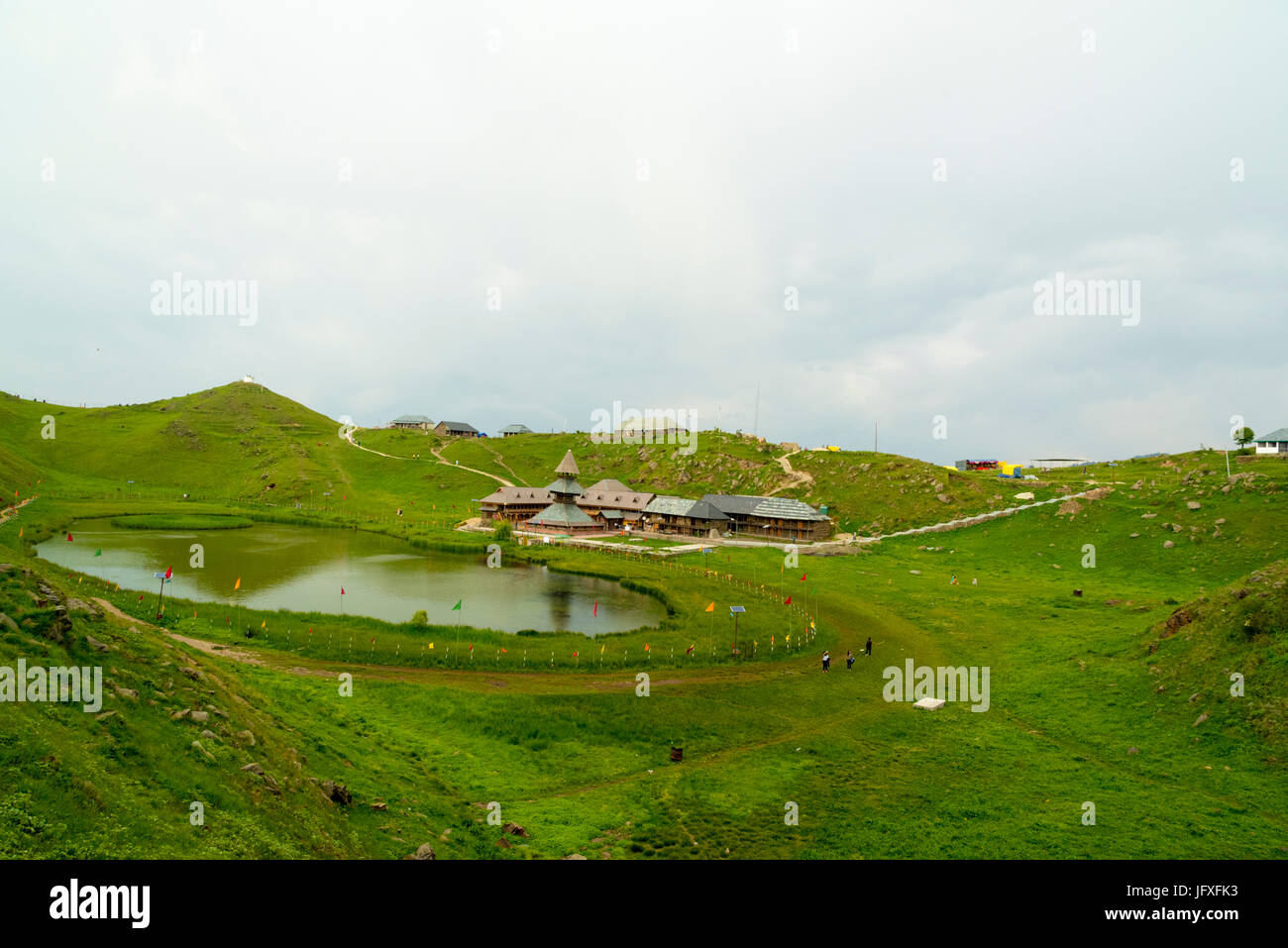 Ancient Prashar Lake Temple view with Prashar Holy water Pond and Green nature landscape at Prashar Lake, Mandi - Stock Image