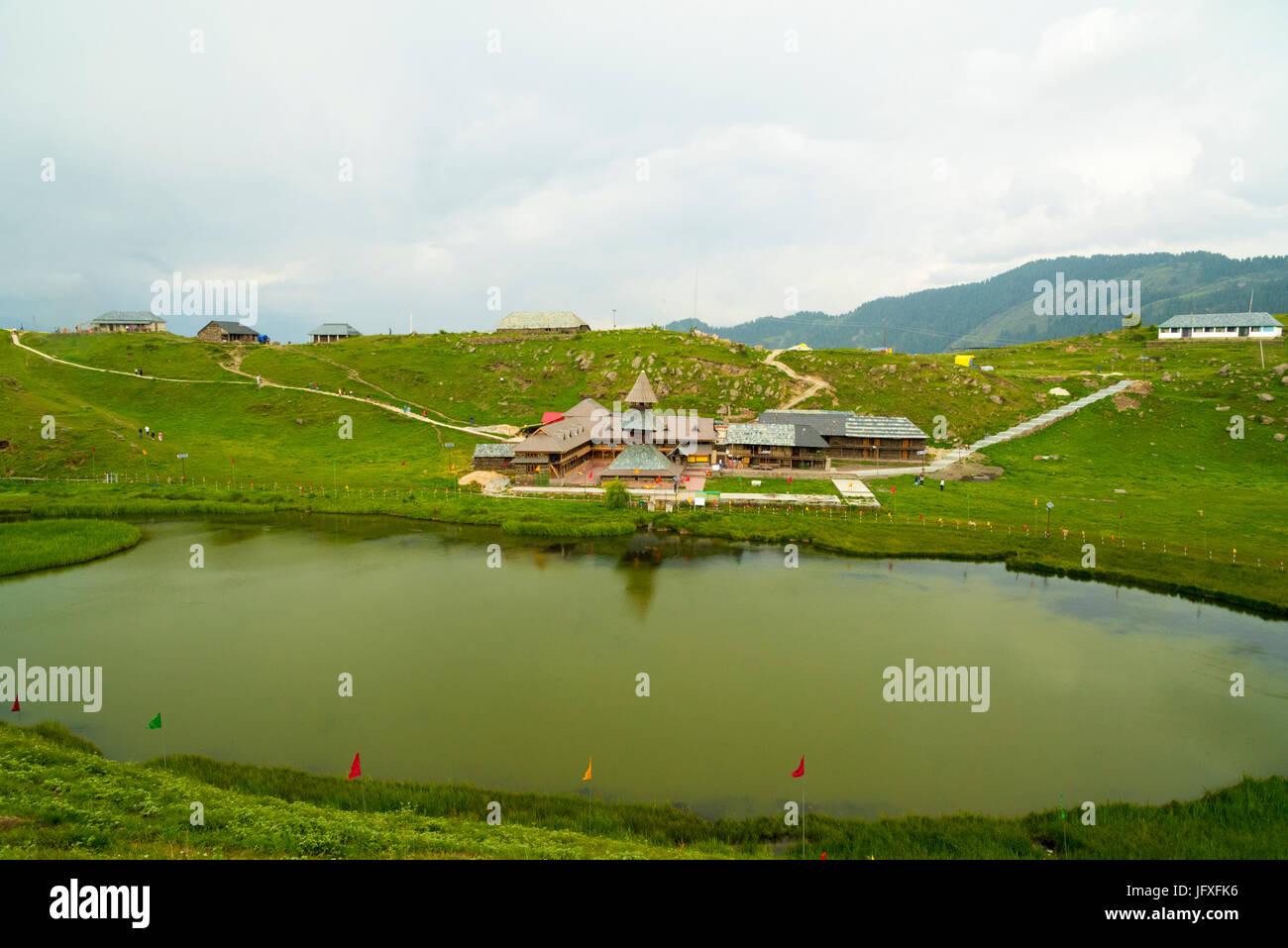 Ancient Prashar Lake Temple view with Prashar Holy water Pond and Green nature landscape at Prashar Lake, Mandi - Stock Image
