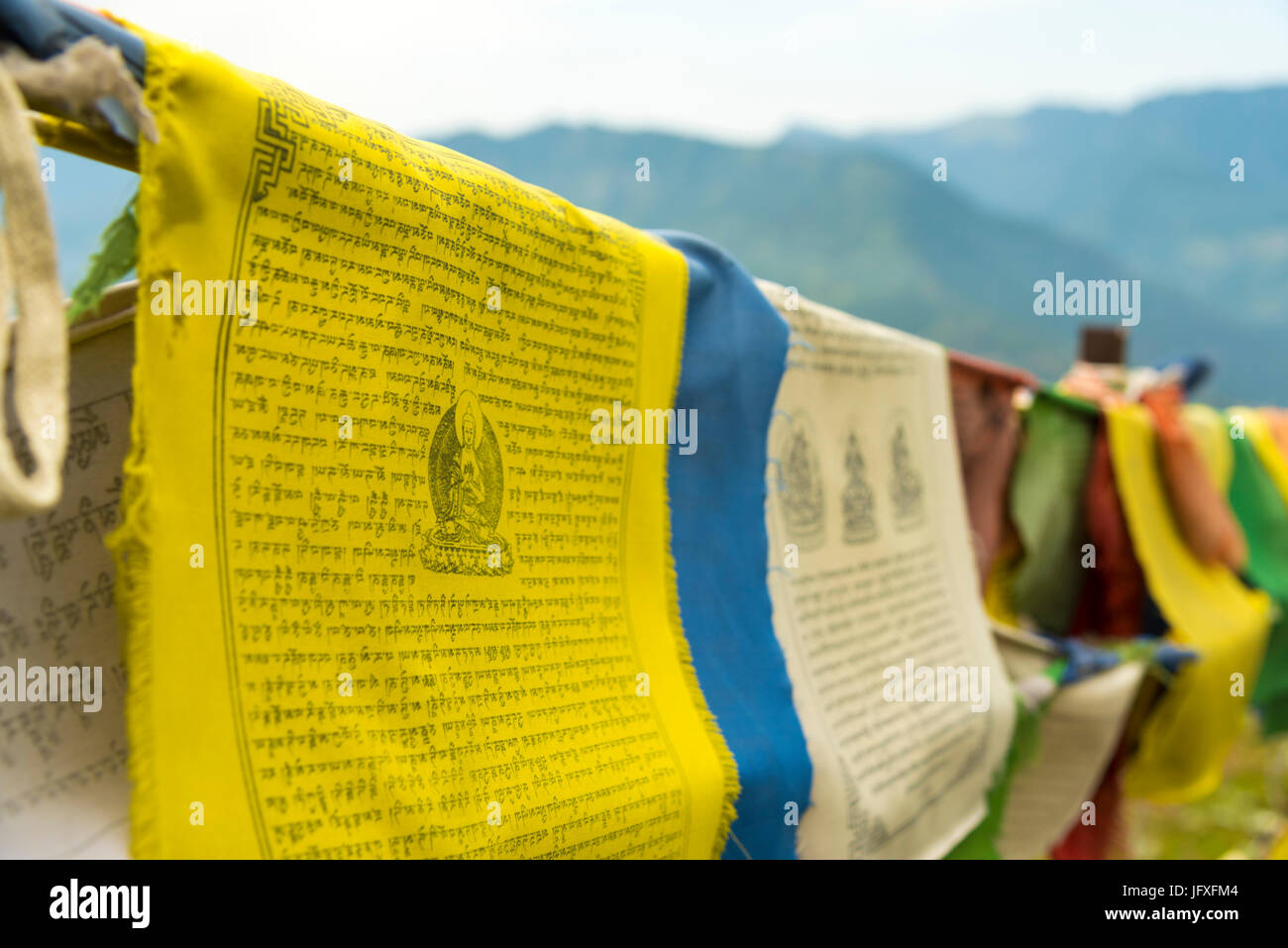 colorful Tibetan prayer flags with detail long text and culture pictures on hanging Tibet flag at Himachal Pradesh - Stock Image