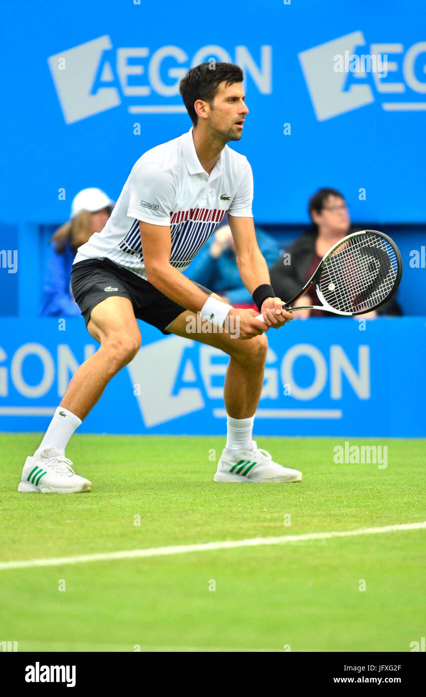 Novak Djokovic (Serbia) playing his first match on centre court at Devonshire Park, Eastbourne, during the Aegon - Stock Image