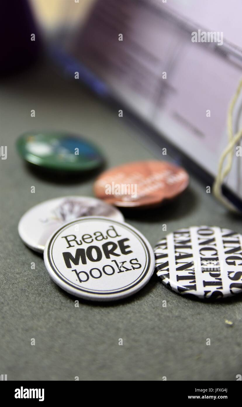 Collection of buttons or badges with a 'Read More Books' button at the center. - Stock Image
