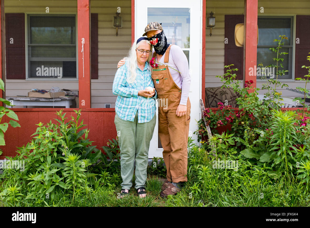 In a time of uncertainty Ellen Gerhart and a member of Camp White Pine stand in the shade of the Gerhart family - Stock Image