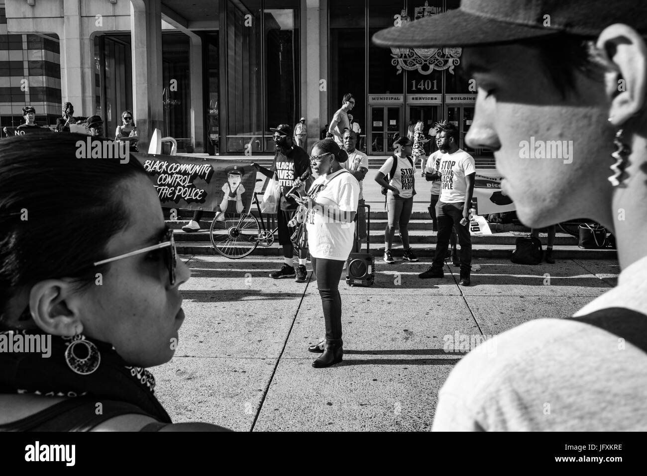 A woman speaks during a rally on police violence in Philadelphia's Center City. - Stock Image