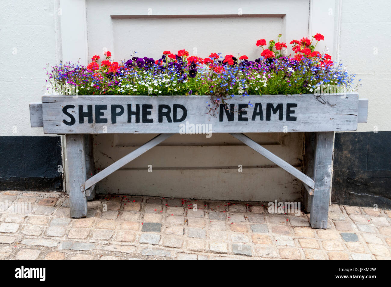 Flower planting outside a Shepherd Neame pub in Kent. - Stock Image