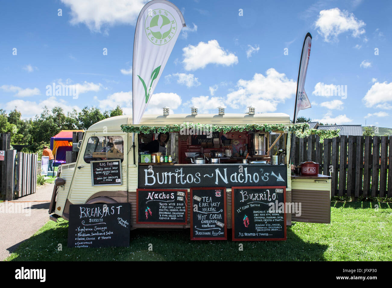 A food truck serving vegetarian Burritos and Nachos at a festival. - Stock Image