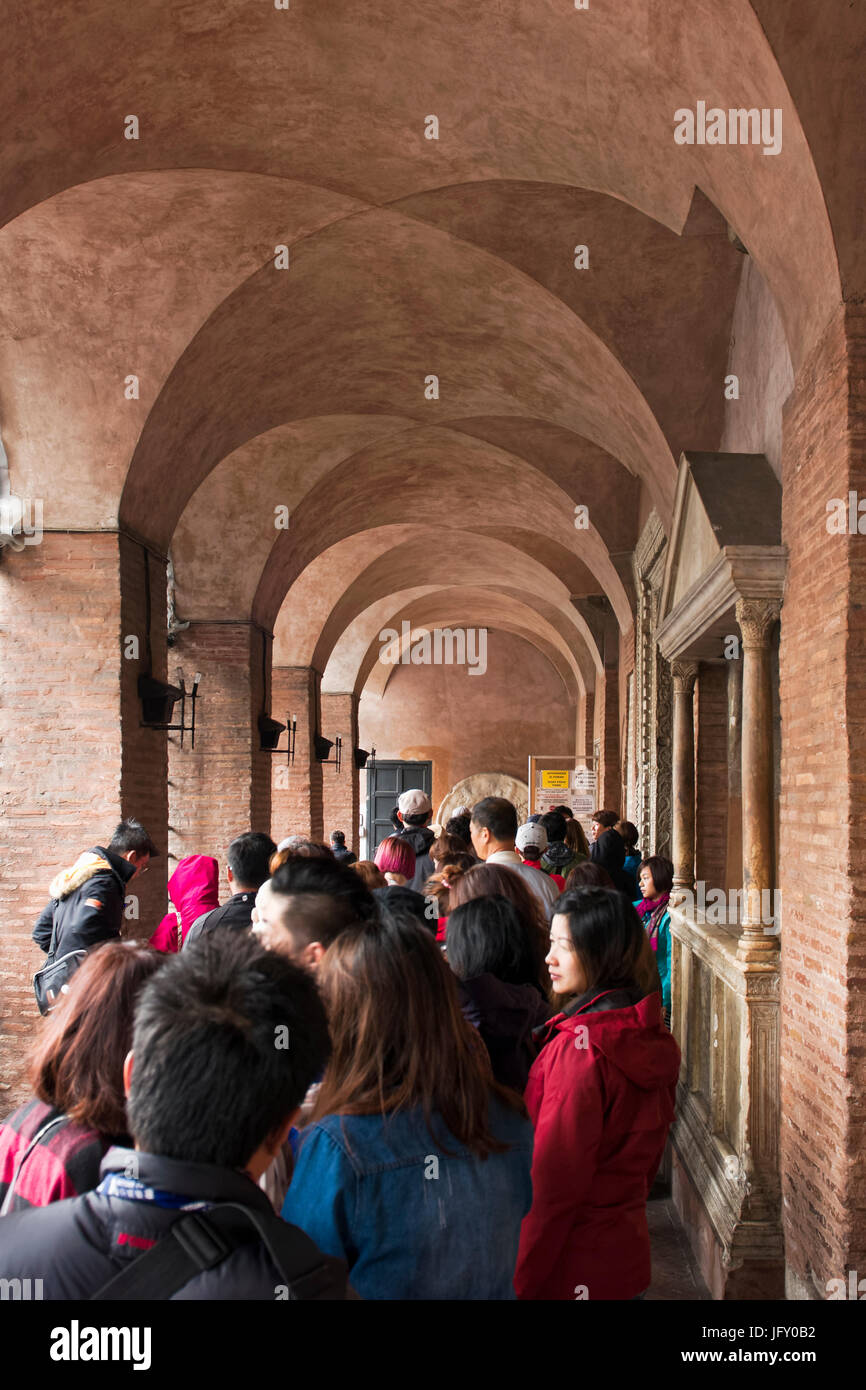 Rome, Italy - October 01, 2015. Tourists waiting to see the famous Mouth of Truth at Basilica of Santa Maria in - Stock Image