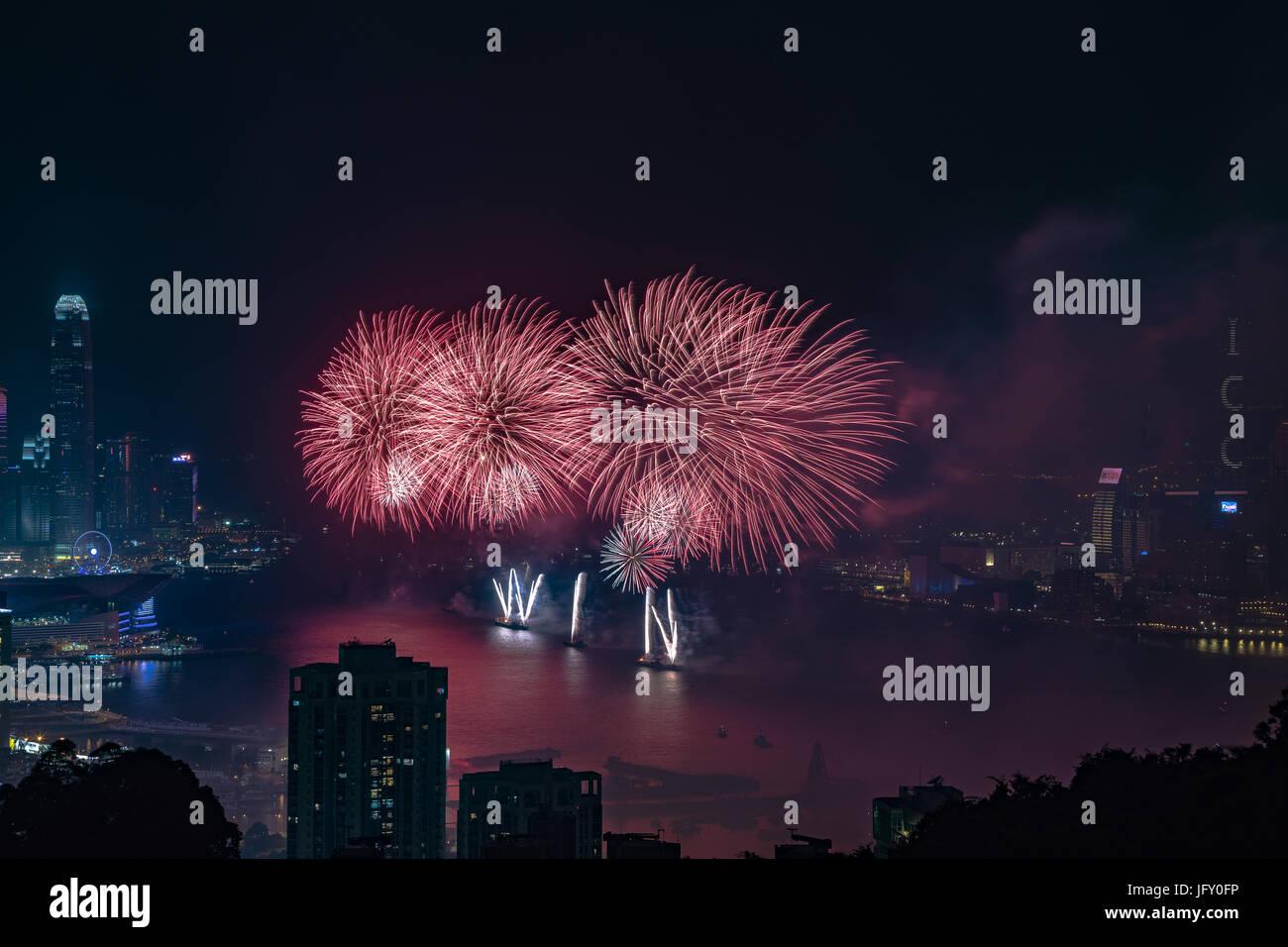 Fireworks at Victoria Harbour, Hong Kong. Commemorating 20th anniversary of Hong Kong handover to China. Credit: Stock Photo