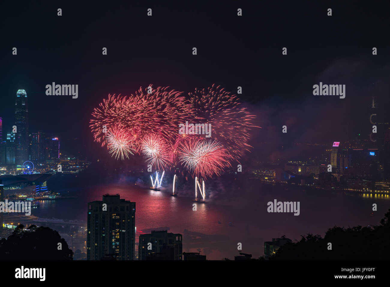 Fireworks at Victoria Harbour, Hong Kong. Commemorating 20th anniversary of Hong Kong handover to China. Credit: Stock Photo