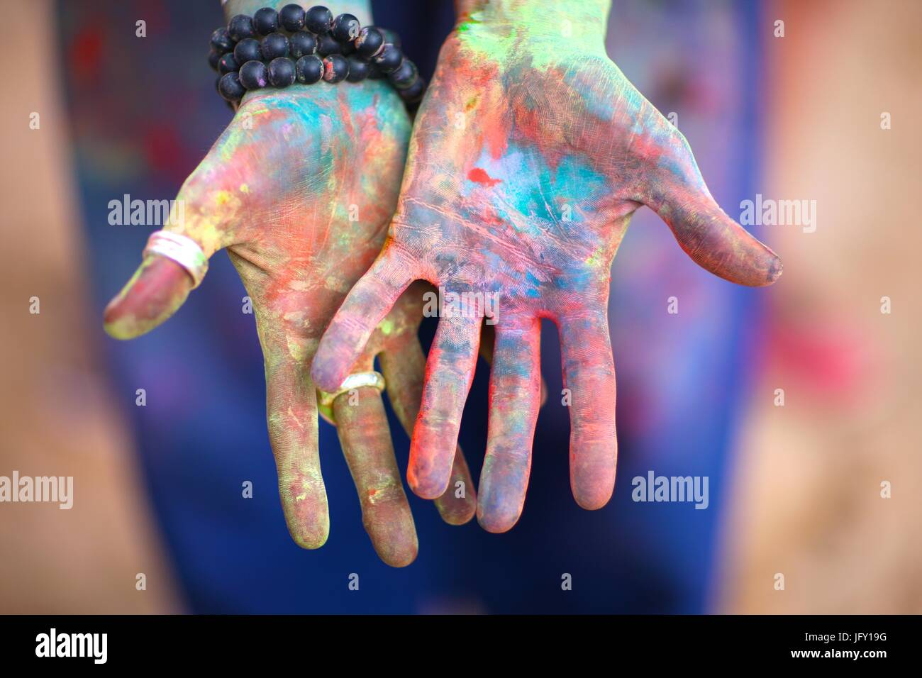 Holi festival participant palms - Stock Image