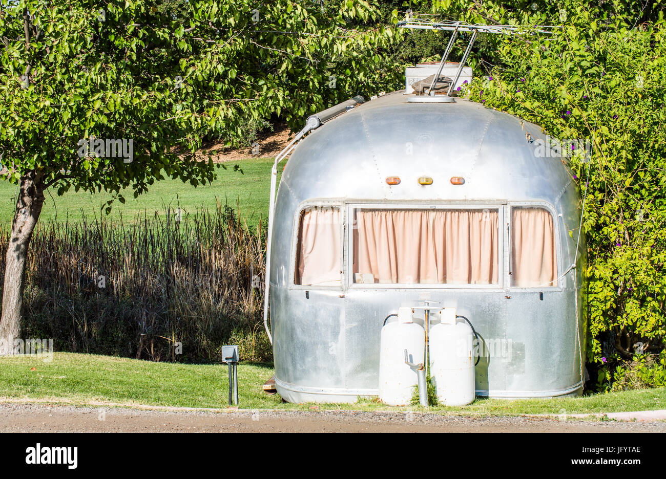 weathered mobile home in abandoned trailer park - Stock Image