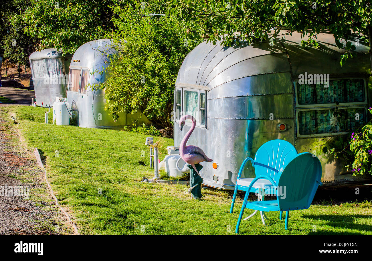 weathered mobile homes in abandoned trailer park - Stock Image