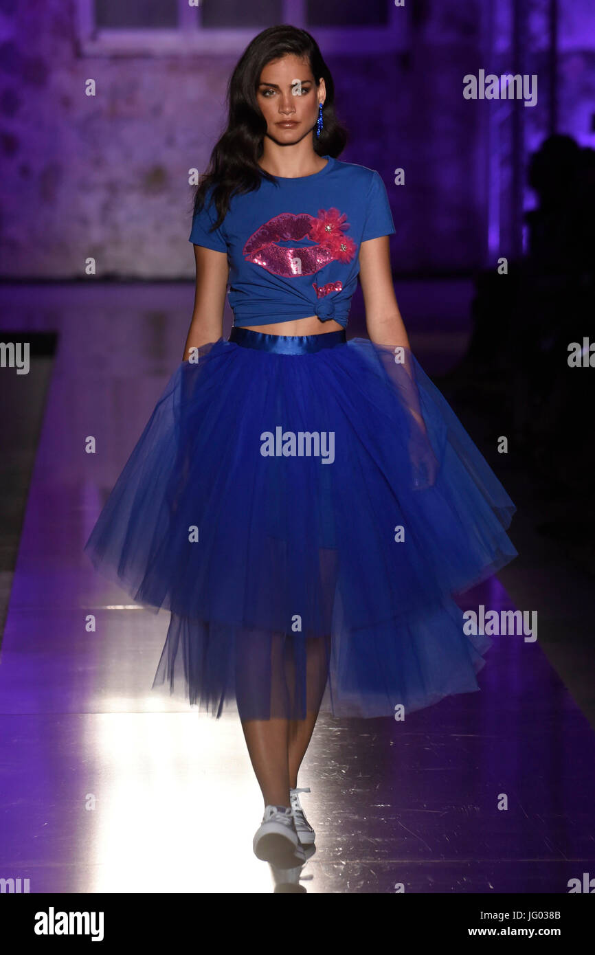 Models wears a creation by Lola Casademunt during the Fall/Winter 2017-2018 fashion show as part of 080 Barcelona - Stock Image