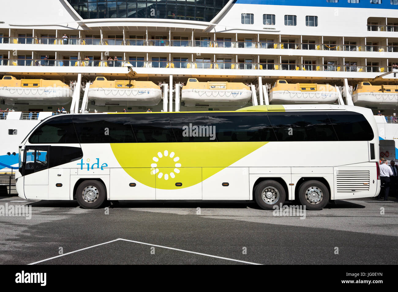 Neoplan Cityliner of tide ASA waiting at AIDAsol for shore excursion passengers. Tide is one of the largest coach - Stock Image