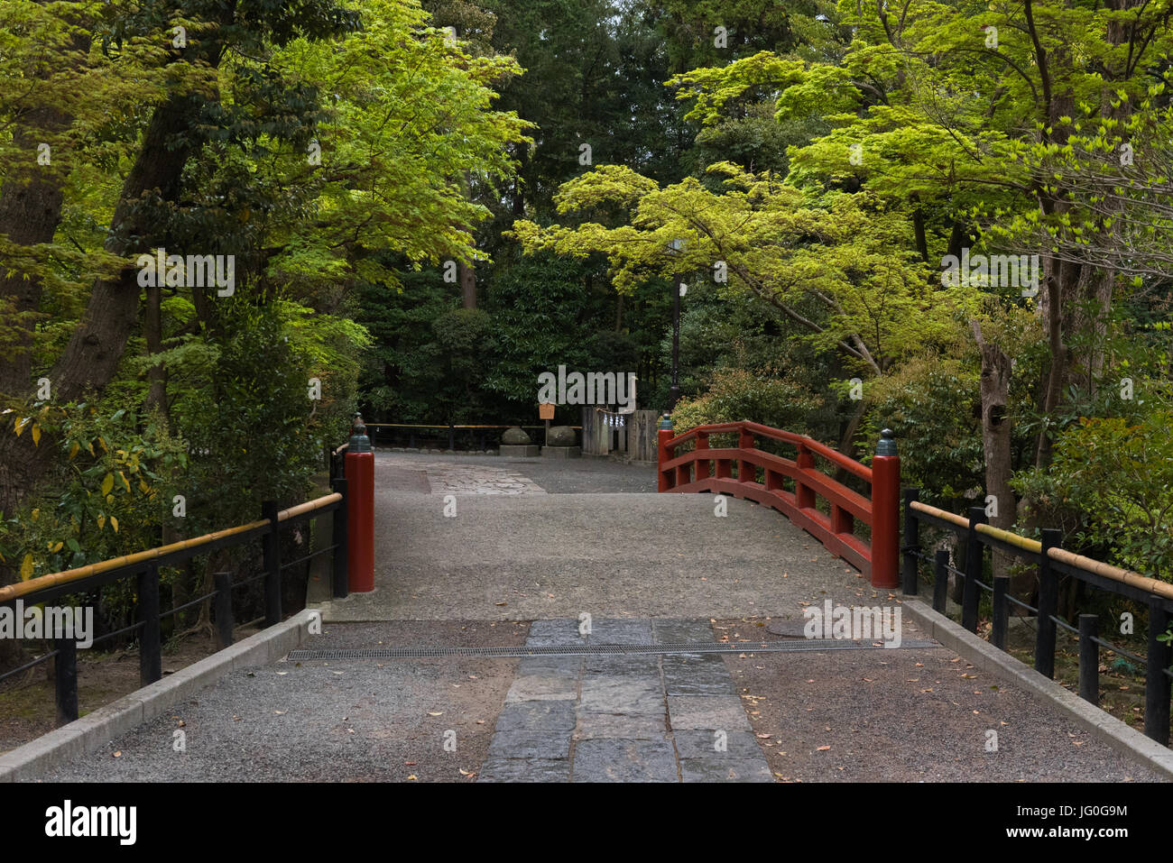 Footbridge leading to Japanese gardens in a park - Stock Image
