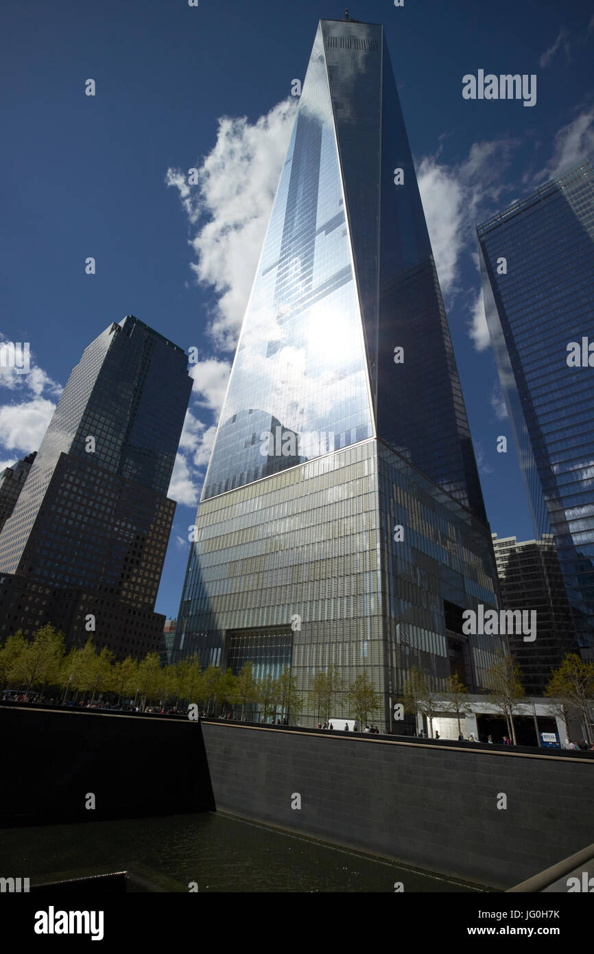 new one world trade center next to north memorial pool former 1 world trade center footprint New York City USA - Stock Image