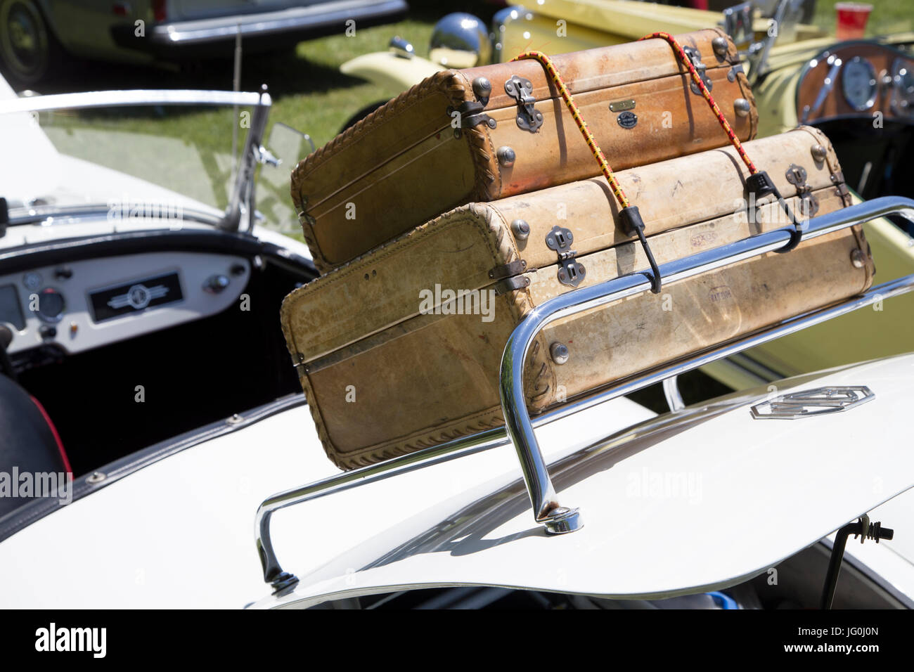 Suitcases on luggage rack on trunk lid of MG car - Stock Image