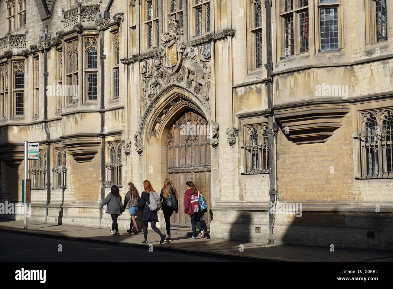 Female students walking past Brasenose college - Stock Image
