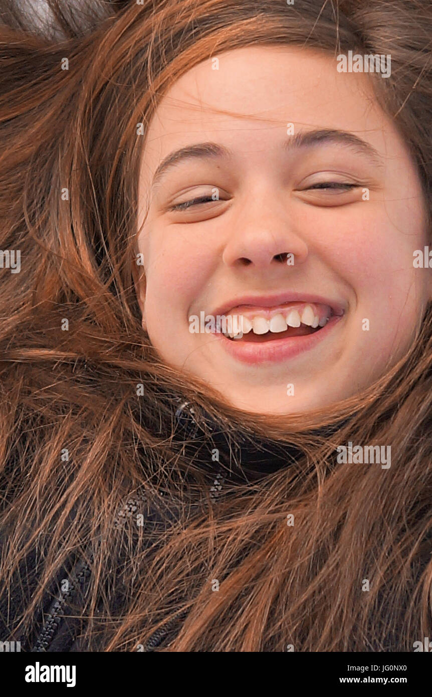 girl laughing with air all around her - Stock Image