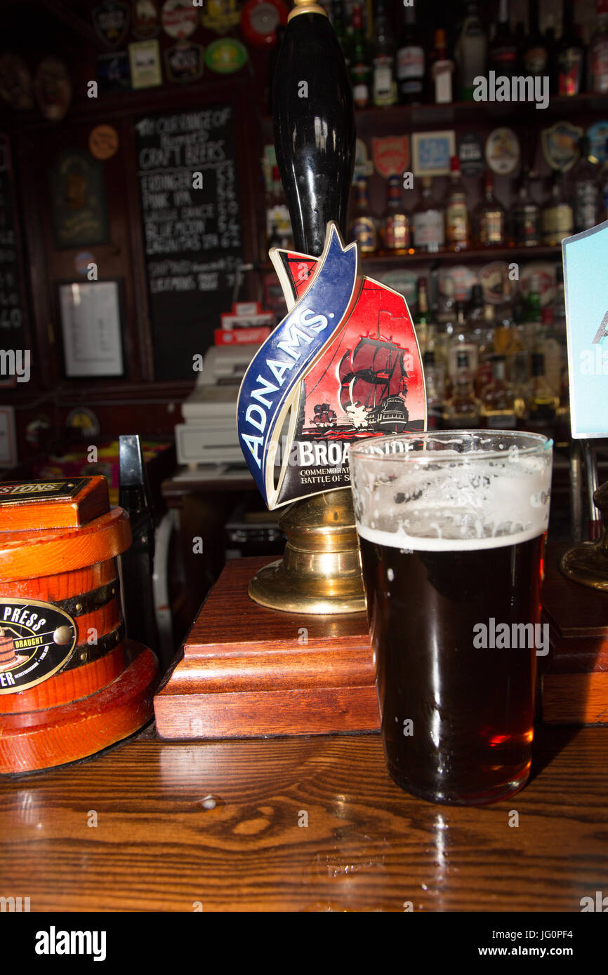 English pint of Adnams Broadside ale with pump clip and font - Stock Image