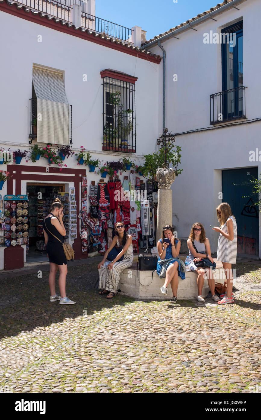Tourists in the small square in the Calleja de las Flores, Cordoba, Spain. Stock Photo