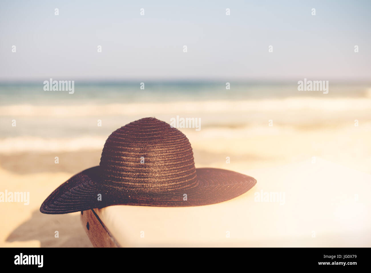 fabba55e35e Black Hat on Beach Chair On The Tropical Sand Beach. Sun