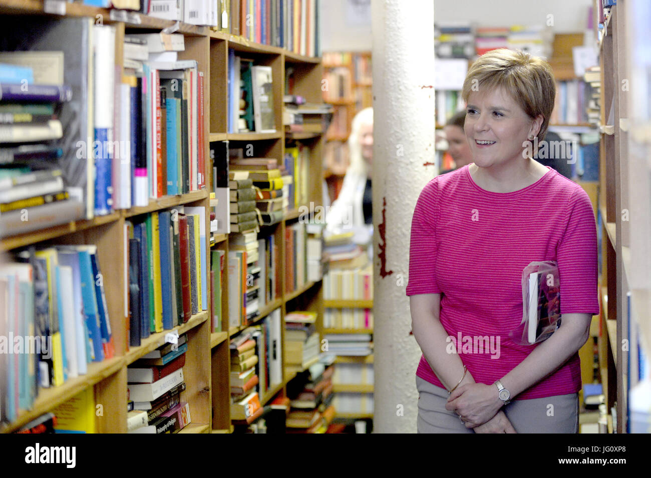 Scotland's First Minister Nicola Sturgeon and SNP candidate Mhairi Black browse a bookshop in Paisley.  Featuring: Stock Photo