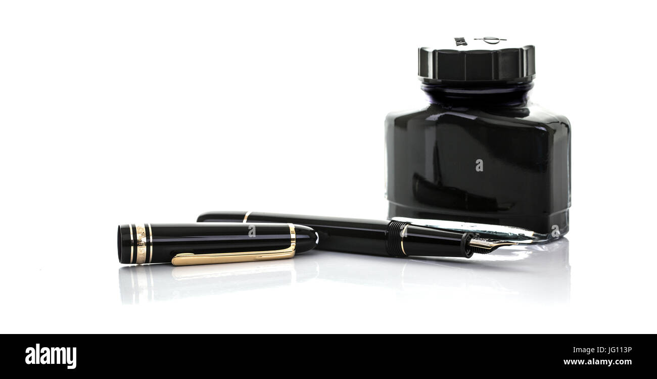 SWINDON, UK - JULY 2, 2017: Close up of a Mont Blanc fountain pen and bottle of ink on a white background - Stock Image