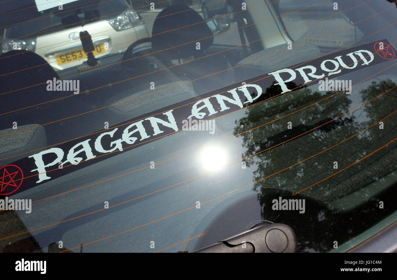 'Pagan and Proud' sticker in car window, London - Stock Image
