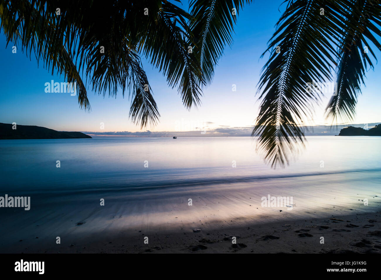 Sunset over the beach of the Korovou Eco-Tour Resort, Naviti, Yasawas, Fiji, South Pacific - Stock Image