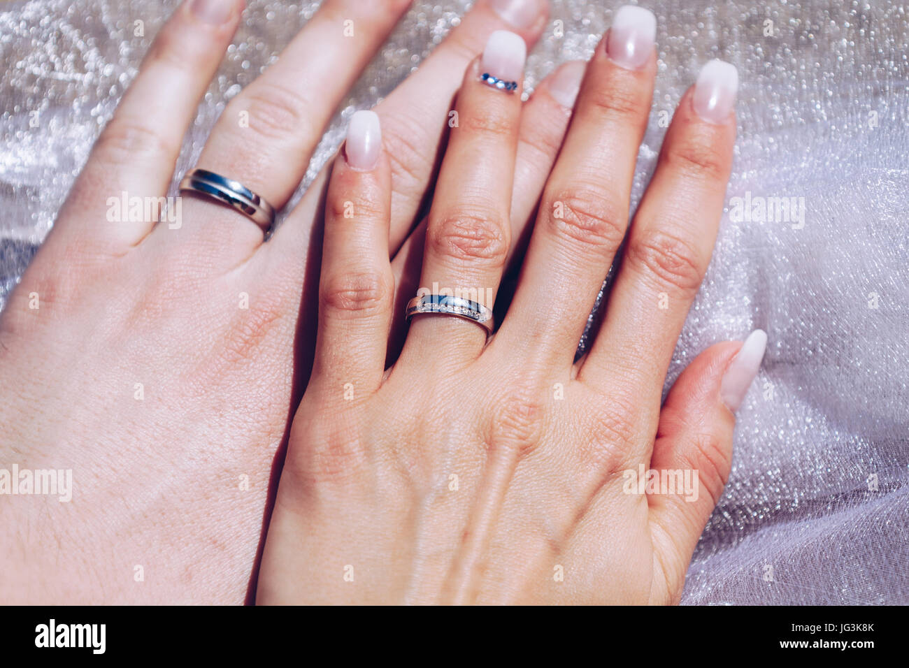 Newly wed couple\'s hands with wedding rings Stock Photo: 147598435 ...