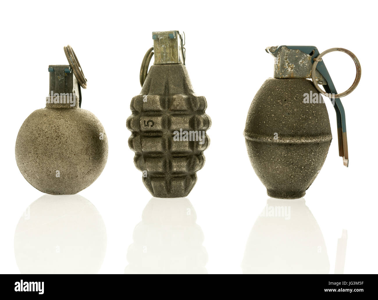 Three grenades of baseball, pineapple and lemon on an isolated background. - Stock Image