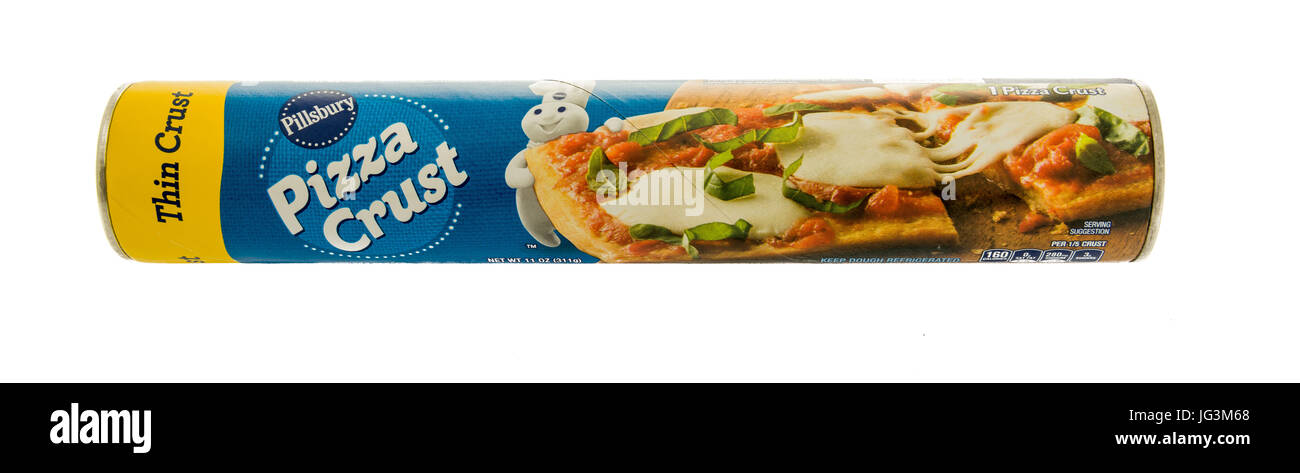 Winneconne, WI - 29 June 2017: A tube of Pillsbury pizza crust on an isolated background. - Stock Image
