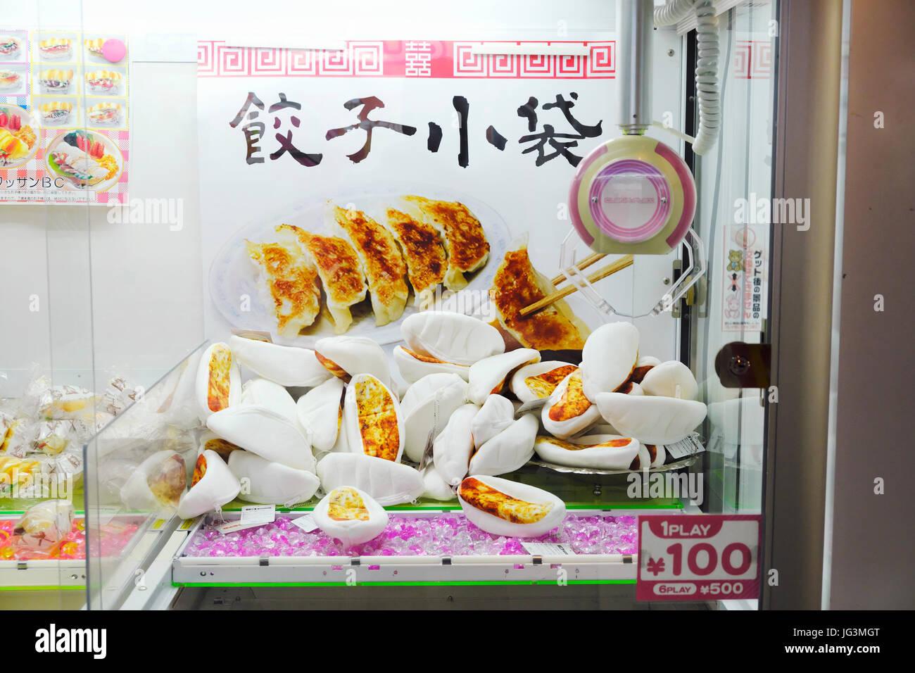 A gyoza claw machine in an amusement center inside HEP Five Shopping Center in Osaka. - Stock Image