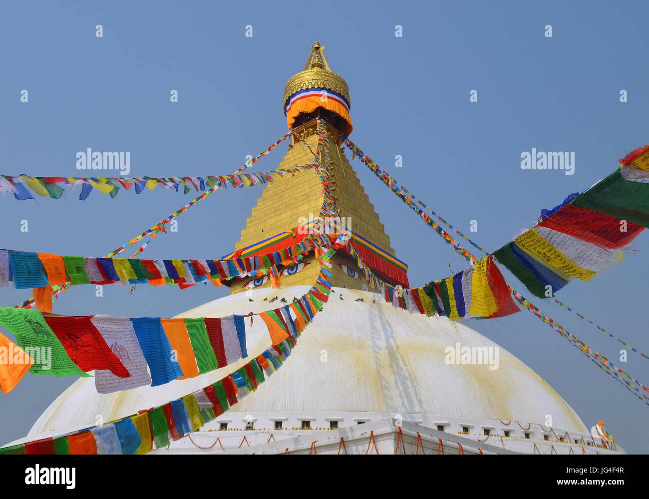 Flags lunghta on The Great stupa Bodnath in Kathmandu - Stock Image