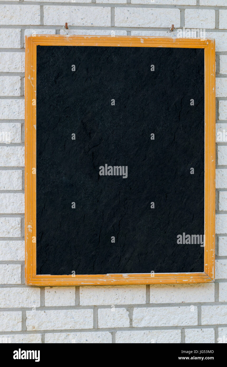 Empty large slate boards with wooden frame on a stone wall Stock ...