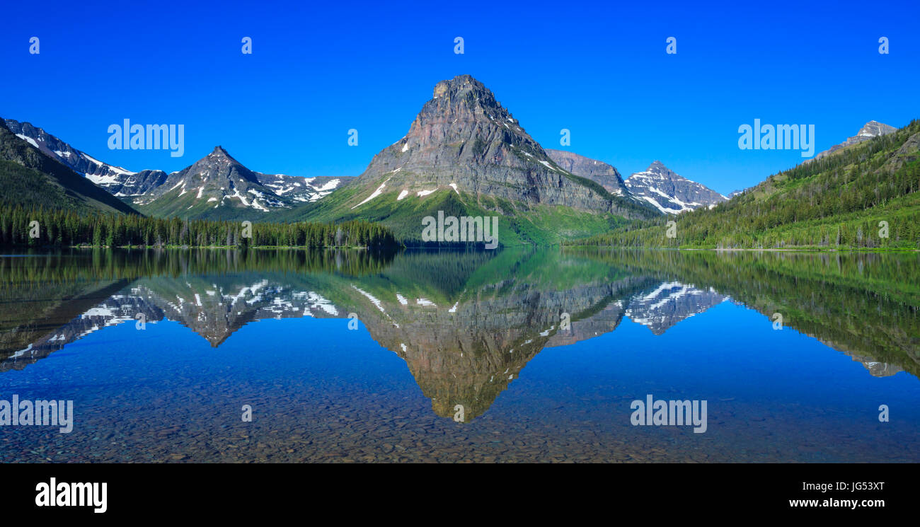 sinopah mountain reflected in two medicine lake in glacier national park, montana - Stock Image