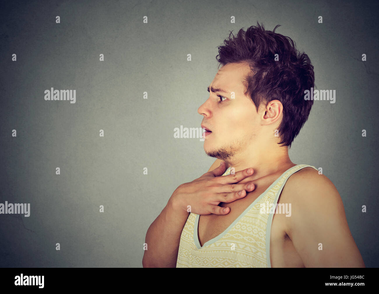 Portrait of a scared anxious young man - Stock Image